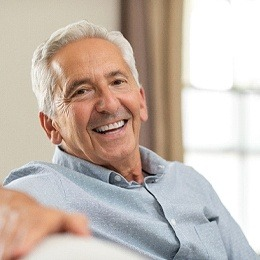 An older man smiling