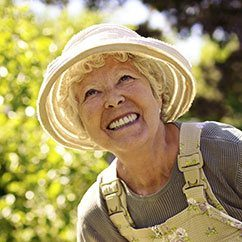 Senior woman in sun hat smiling