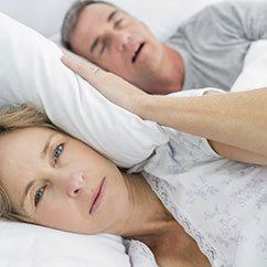 Wife bothered by husband snoring