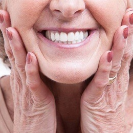 Woman showing dentures