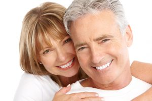 couple smiling about tooth replacement