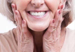 Smiling face wearing dentures