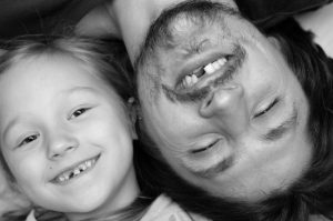 Father and daughter with missing teeth in arlington need smile restoration