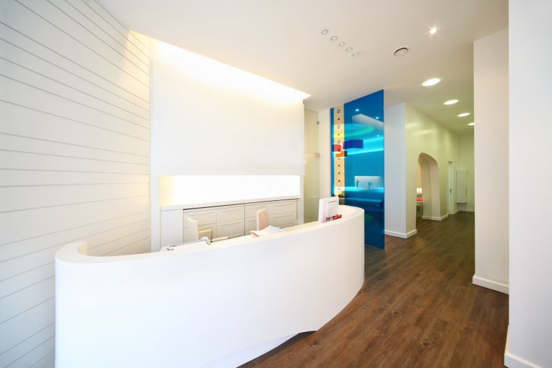 an empty dental office that is free of reading materials and other amenities for patients